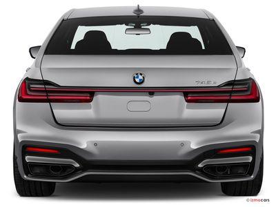 Miniature de la BMW SERIE 7 M SPORT 745E 394 CH BVA8 4 PORTES à motorisation HYBRIDE RECHARGEABLE et boite AUTOMATIQUE de couleur GRIS - Miniature 4