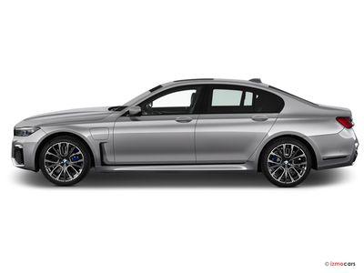 Miniature de la BMW SERIE 7 M SPORT 745E 394 CH BVA8 4 PORTES à motorisation HYBRIDE RECHARGEABLE et boite AUTOMATIQUE de couleur GRIS - Miniature 5